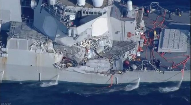 Navy destroyer collides with container ship; sailors missing