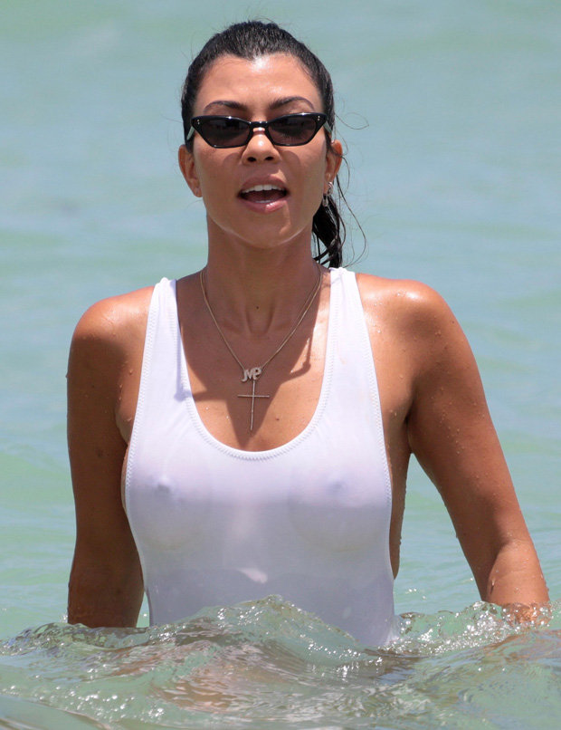 Kourtney Kardashian parades nipples in privates-skimming swimsuit