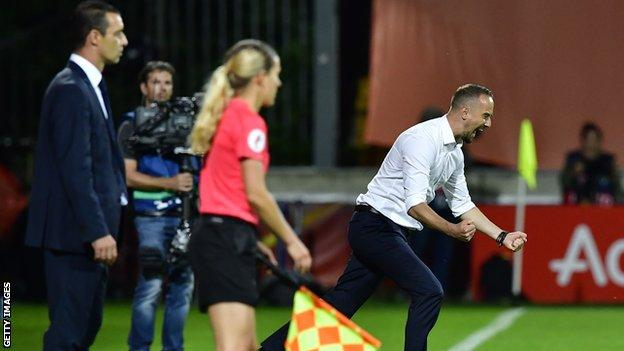 Mark Sampson celebrates