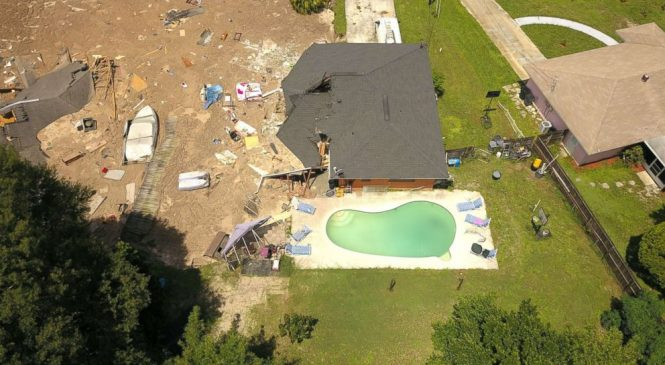 Sinkhole swallows boat, 2 houses; others at risk