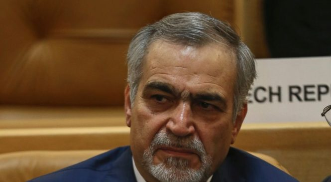 Iran detains president's brother, sentences American