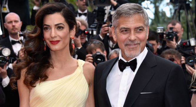 Clooney vows to sue magazine over photos of twins