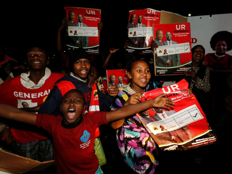 Supporters of incumbent President Uhuru Kenyatta celebrate after he was announced winner of the presidential election at the IEBC National Tallying centre at the Bomas of Kenya, in Nairobi, Kenya August 11, 2017. REUTERS/Thomas Mukoya