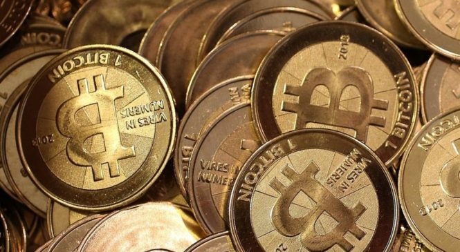 Bitcoin rebels risk 'currency trading chaos'