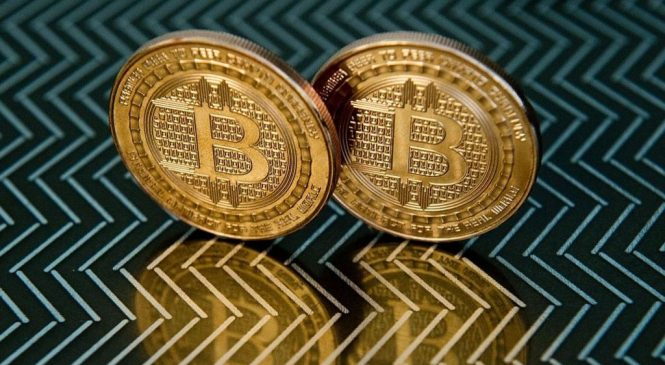 Bitcoin splits as new currency takes off