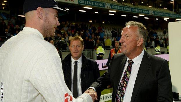 Stuart Broad shakes hands with Sir Ian Botham