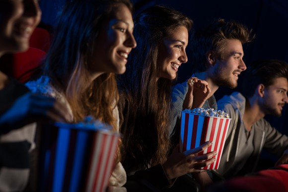 Theatergoers eating popcorn