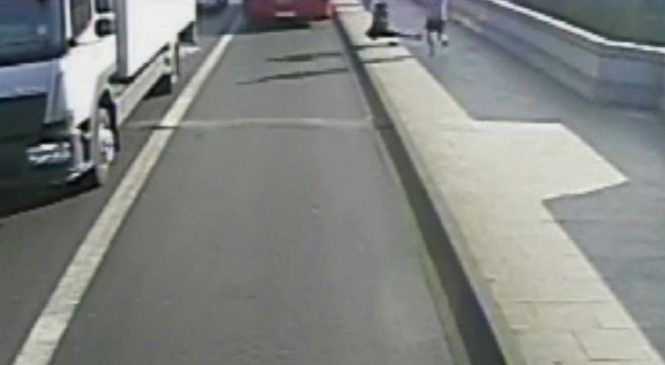 Jogger appears to push woman into oncoming traffic in video