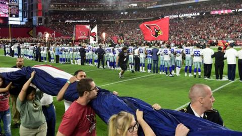 Dallas players & owner kneel before anthem to join NFL protest