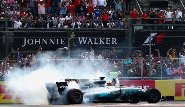 Mercedes' Lewis Hamilton wins fourth Formula One world championship to become most successful British driver of all time