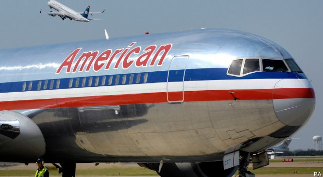 A black-rights group warns would-be passengers about American Airlines
