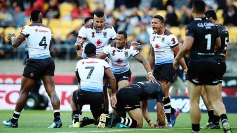 Fiji team celebrate winning a penalty