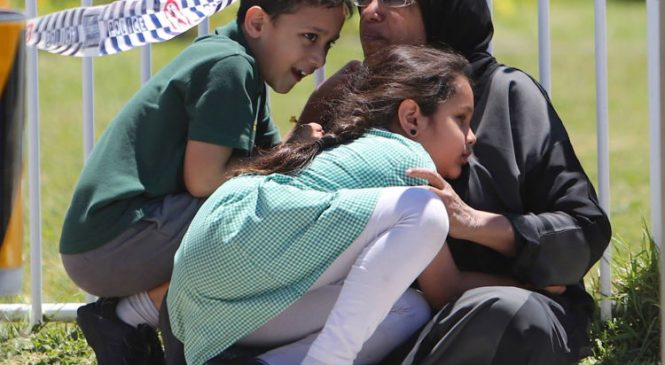 Two children killed as car crashes into school