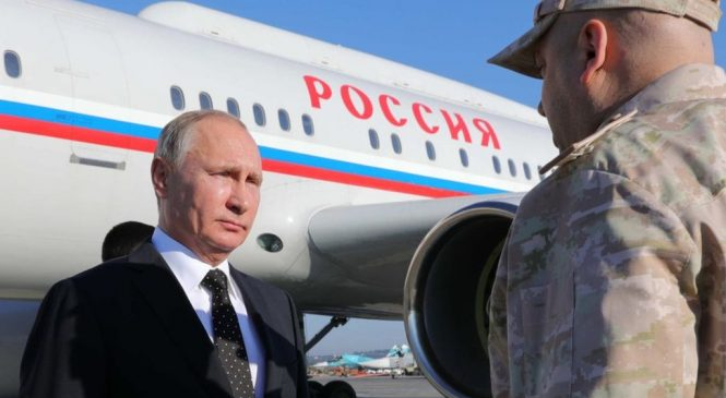 Putin announces Russian troop withdrawal from Syria during visit