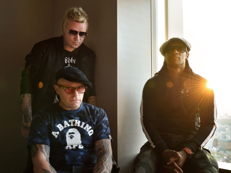 O GO WITH Britain-music-Prodigy-Japan-entertainment,INTERVIEW by Alastair HIMMER This photo taken on August 13, 2015 shows members of the British band The Prodigy, Liam Howlett (top L), Keith Flint (bottom L), and Maxim (R) posing prior to an interview in Tokyo. Techno-punk rockers The Prodigy, who took the world by storm with their angry lyrics and controversial videos in the 1990s, want to be viewed as a British 'national treasure.' AFP PHOTO / KAZUHIRO NOGI (Photo credit should read KAZUHIRO