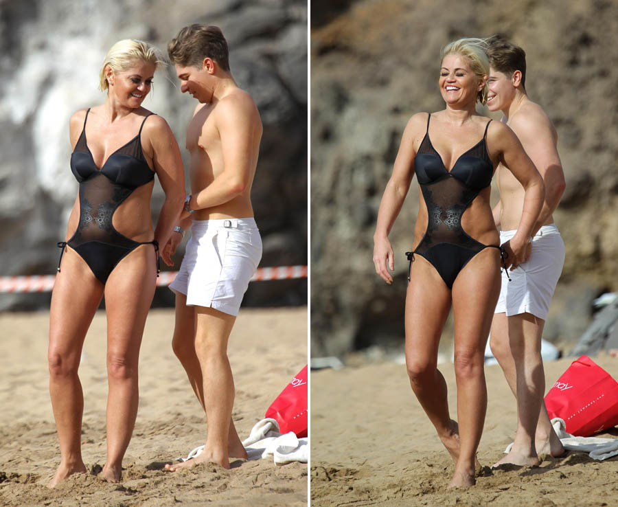Danniella Westbrook wears a black cut-out swimsuit