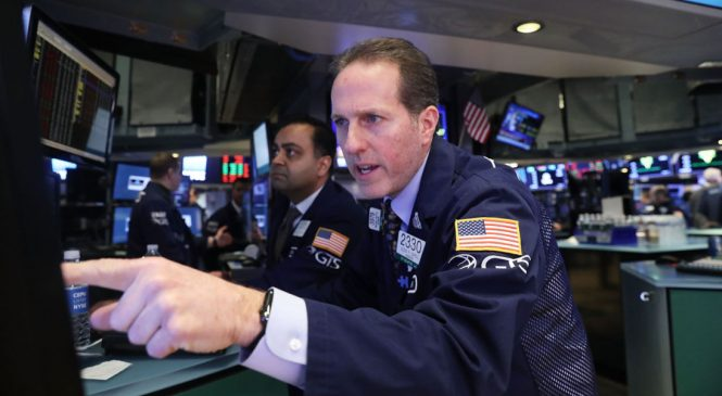 Record falls on Wall St spark losses worldwide