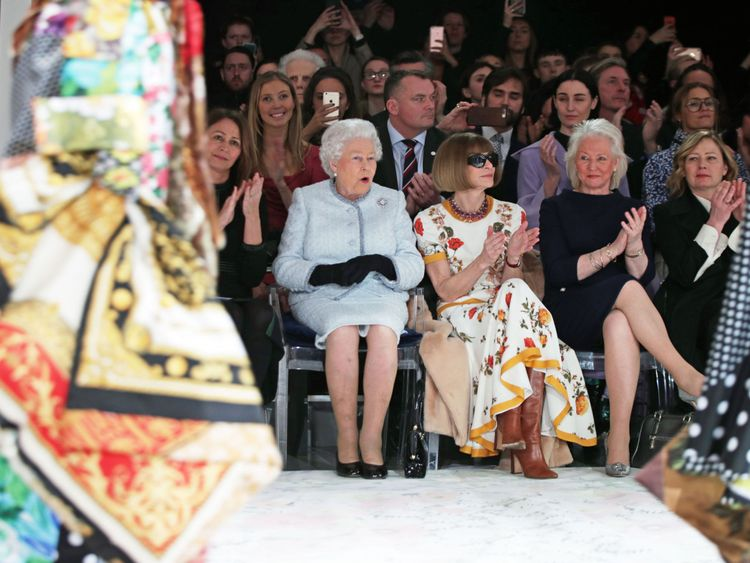 The Queen appeared surprised at some of the outfits as she sat next to Anna Wintour