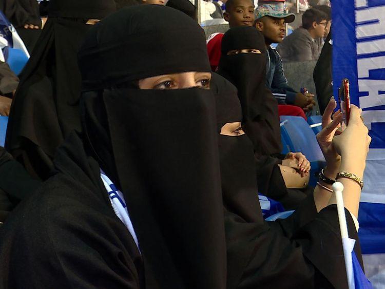 A Saudi woman watching a football match