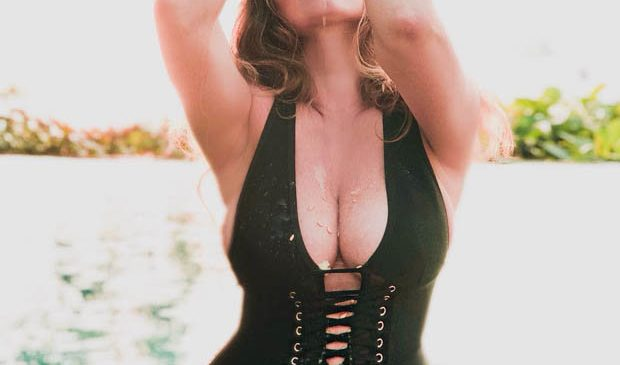 Kelly Brook unleashes melons in lace-up swimsuit slashed to navel