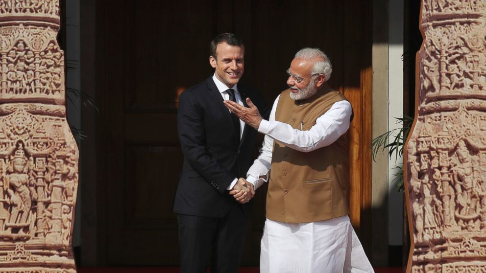 French president pokes at Trump for leaving Paris accord