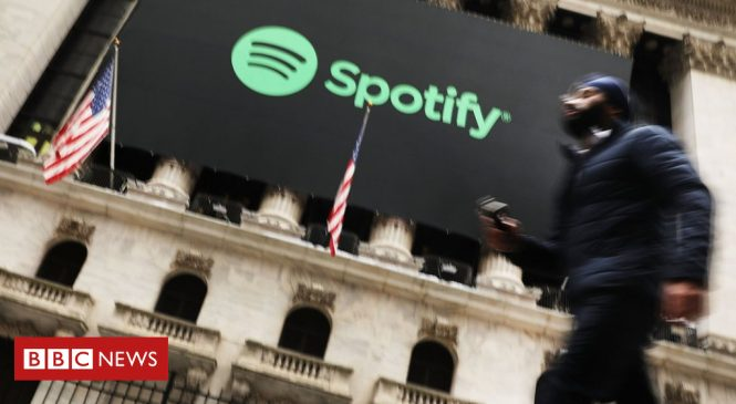 Spotify shares dip on first day of trading