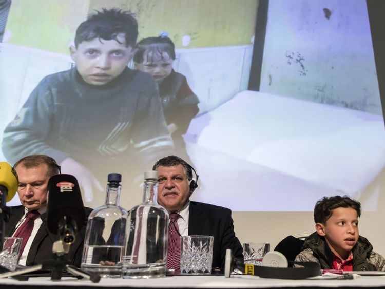 Ambassador Shulgin (L) and 11-year-old Hassan Diab, (R) at the briefing