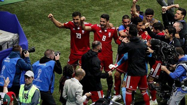 Iran celebrate a disallowed goal