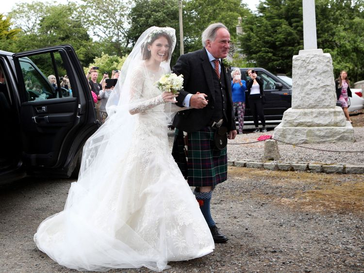 Rose Leslie with her father, arriving at church in Aberdeenshire