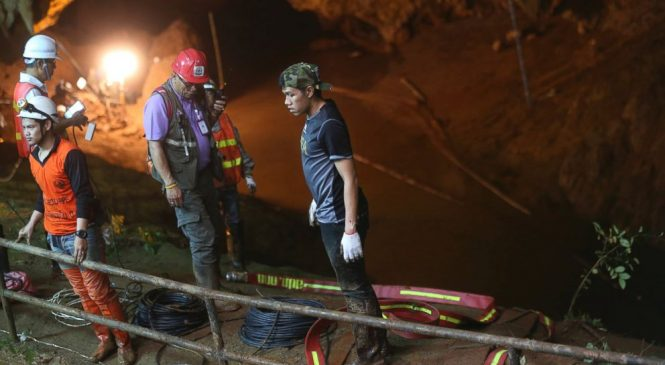 Desperate search for boys' soccer team lost in Thailand cave hampered by rains
