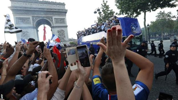 France players on an open-top bus parade