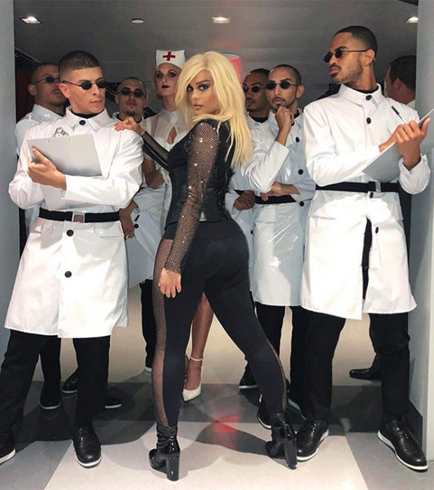 Bebe Rexha shows off bum next to scientists