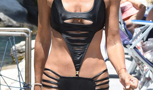 Lady Victoria Hervey teeters on toplessness in scandalously slashed swimsuit