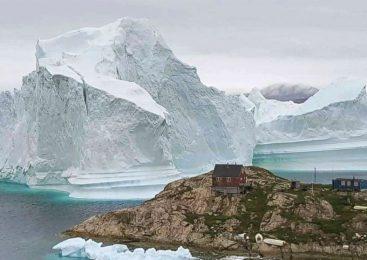 Massive iceberg threatening Greenland village moves away from coast