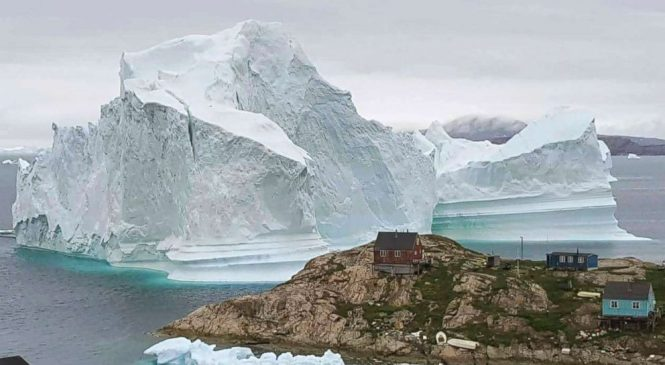Massive iceberg threatening Greenland village moves away from coast