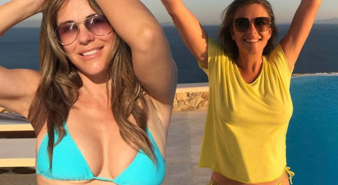 Liz Hurley dares to bare in frontless gown clip: 'I've watched this for an hour'