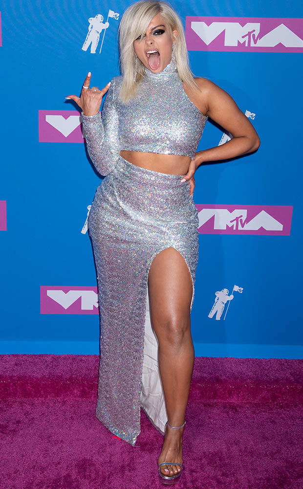 Bebe Rexha showed some attitude in a glittery crop top and high-cut skirt
