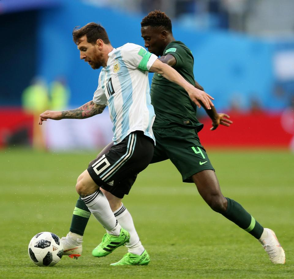 Ndidi tangles with Lionel Messi at the World Cup