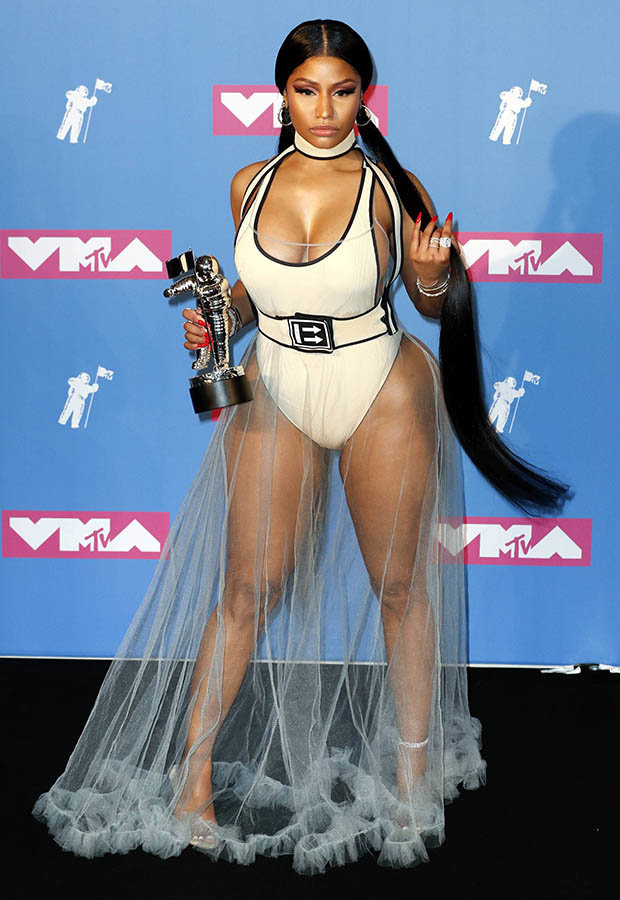 Nicki Minaj wowed in a slashed swimsuit