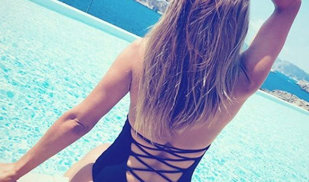 Corrie's Samia Longchambon unleashes booty in daring cut-out swimsuit