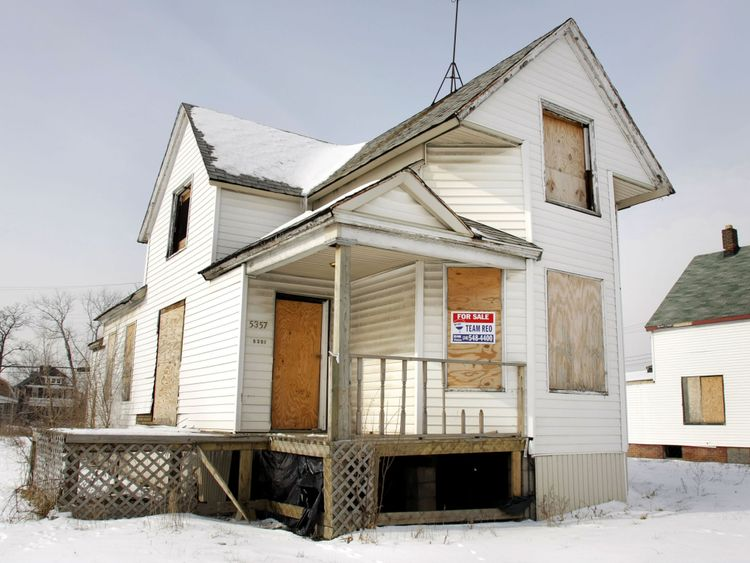 A boarded up house sits for sale in February 2008 in Detroit, Michigan