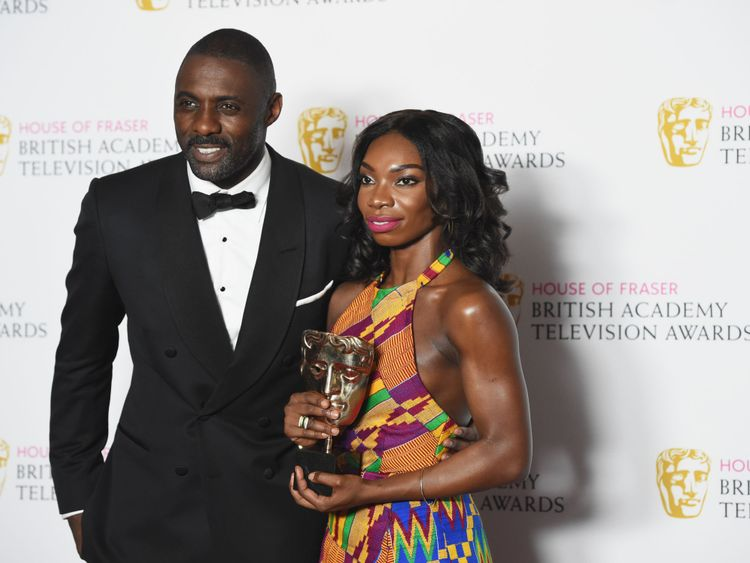 Coel poses with Idris Elba after winning a Bafta for her role in Chewing Gum
