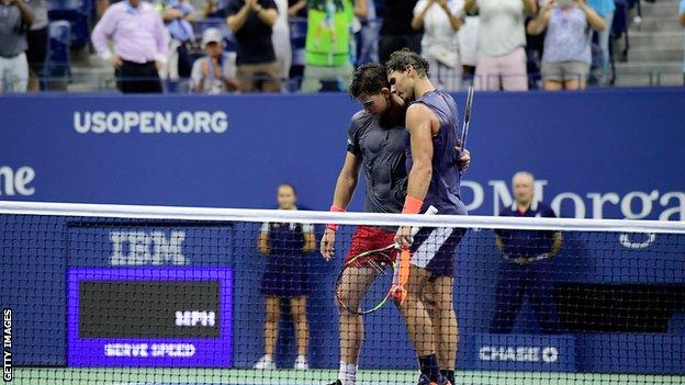 Rafael Nadal consoles Dominic Thiem after their quarter-final