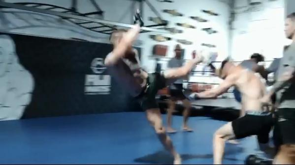Conor can be seen executing a kick to the head of another sparring partner
