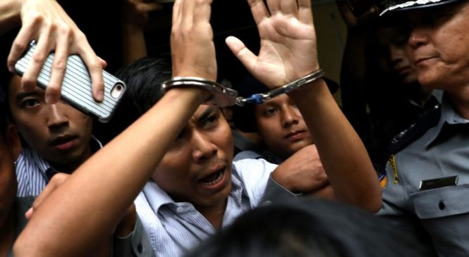 Myanmar jails journalists over secret Rohingya files