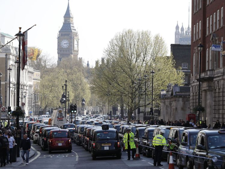 London's black cab drivers block Whitehall during a demonstration over the regulation private hire cars using the Uber app in London on April 6, 2017. / AFP PHOTO / Adrian DENNIS (Photo credit should read ADRIAN DENNIS/AFP/Getty Images)