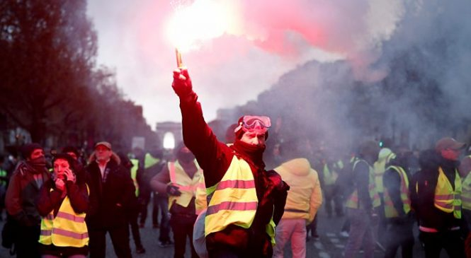 France fuel protests: Police in Paris fire tear gas