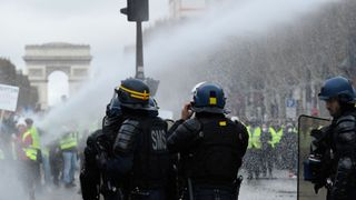 Water cannon has been deployed to disperse the protesters