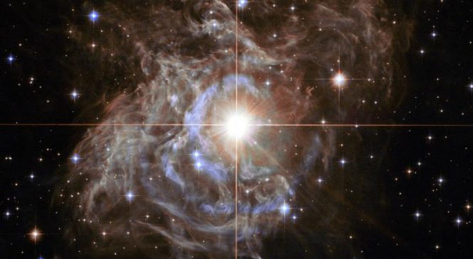 Hubble image offers holiday 'wreath' in the sky