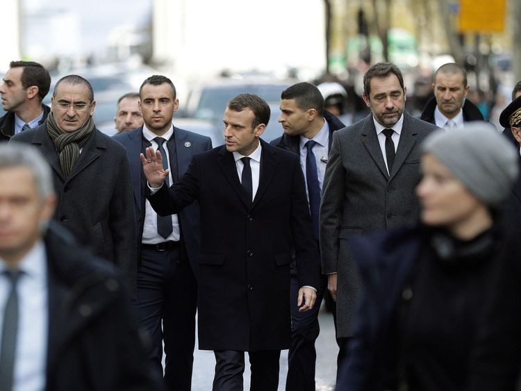 Emmanuel Macron (C) with Interior Minister Christophe Castaner (2ndR) and Paris police chief Michel Delpuech (R) arrive at the Arc de Triomphe